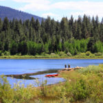 featuring image of two people fishing at Spooner lake