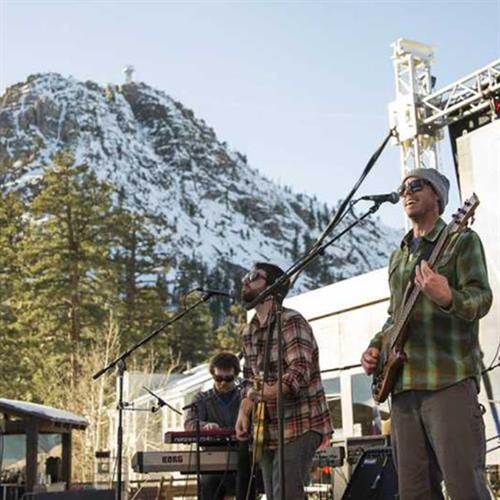 inline image showing band playing music at the base of Squaw Mountain