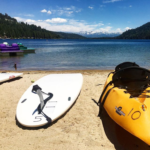 featured image showing a paddleboard and kayak at West End Beach in Truckee