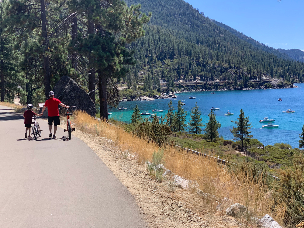 featured image showing father and son leisurely biking on the Tahoe East Shore Trail