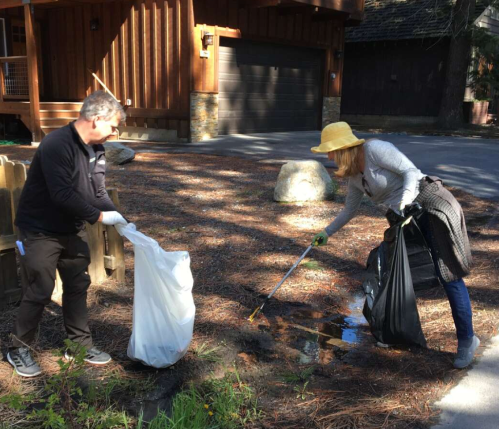 featured image showing two volunteers picking up trash in Truckee, CA