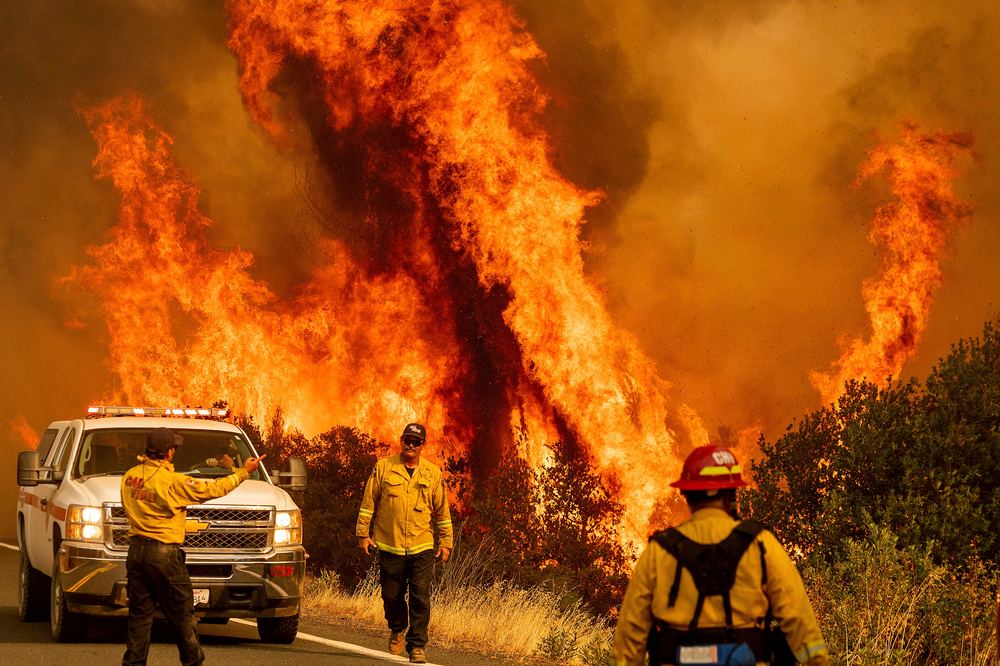 Featured image showing Flames from the LNU Lightning Complex fires leap above Butts Canyon Road on Sunday as firefighters work to contain the blaze in unincorporated Lake County, California